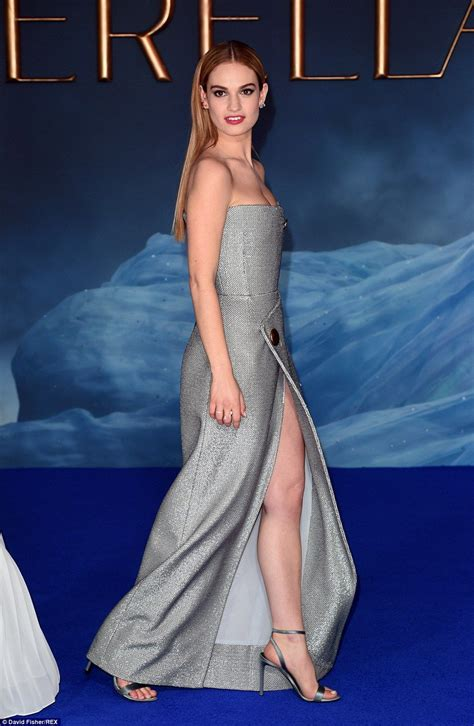 Lily James sparkles in thigh high split gown at Cinderella